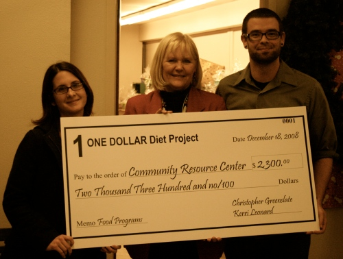 Presenting the check to Community Resource Center exuctive director Laurin Pause. Photo by Lynda Holeva.