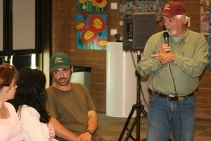 "Jules Dervaes seeks his kid's input before answering a question from the audience after the film screening of ""Homegrown Revolution"", a short documentary of their urban homestead in Pasadena where they grow 6,000 pounds of produce on one tenth of an acre each year. Photo by Christopher."