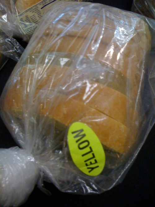 "The Los Olivos dining hall at California Polytechnic University at Pomona is fascinating microcosm of the American food system, where in addition to health vegan options you can also find things like this: a bread just labeled ""Yellow."" Photo by Christopher."