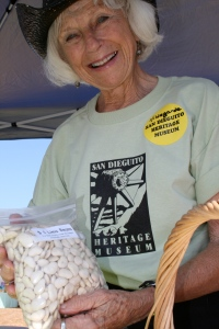 Hildegarde, a volunteer with the San Dieguito Heritage Museum, selling dried lima beans to attendees of the faire. Photo by Christopher.